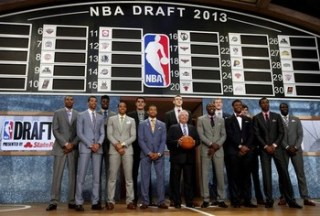 Top prospects pose together with NBA Commissioner David Stern for a group picture before the start of the 2013 NBA Draft in Brooklyn,  New York